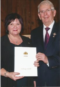 Glenna Campbell-Peardon accepts Heritage award from Lt. Gov. Frank Lewis - 2017